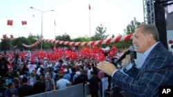 土耳其總統埃爾多安星期天在一個集會上。