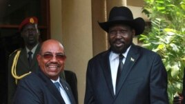Description: South Sudan's President Salva Kiir (R) welcomes his Sudanese counterpart Omar al Bashir outside his presidential office in Juba on Friday, April 12, 2013. (Reuters)
