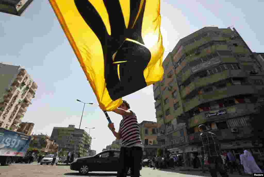 A supporter of Egypt's ousted President Mohamed Morsi waves a banner during a march in Cairo, Oct. 4, 2013.