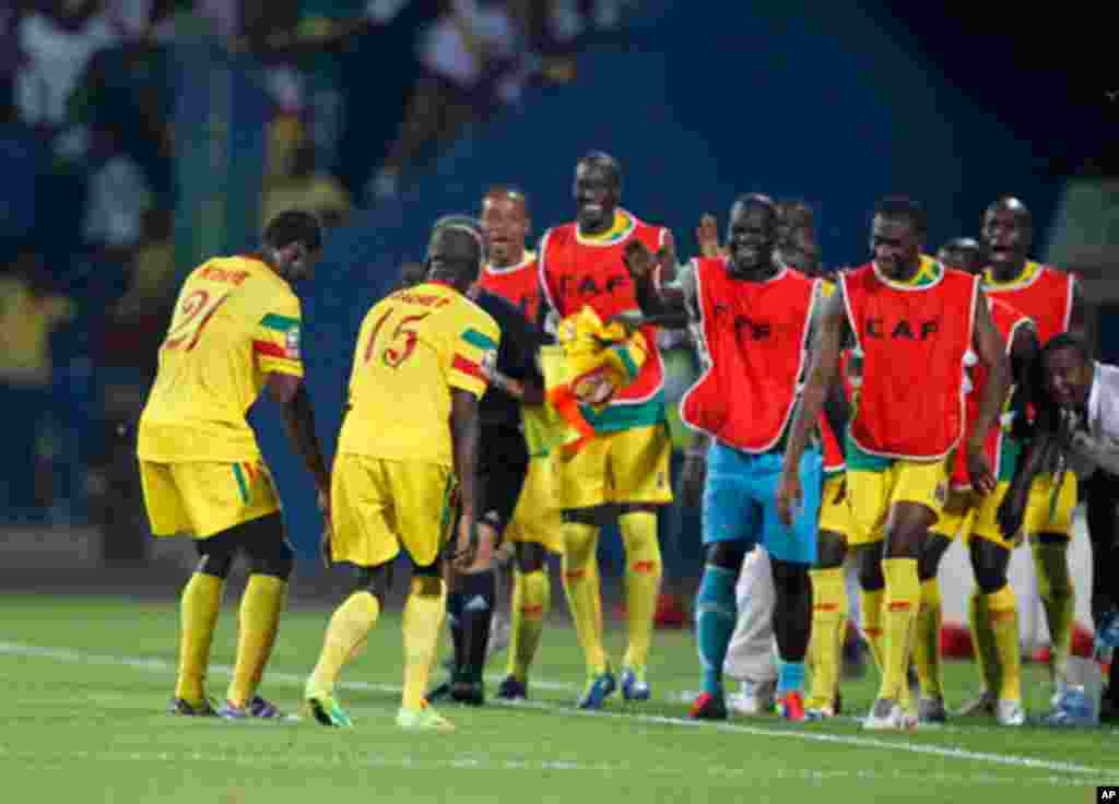 Mali's Bakaye Traore celebrates his goal with teammates during their African Nations Cup Group D soccer match against Guinea at Franceville Stadium