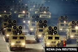 Military vehicles are seen during a parade to mark the 75th anniversary of the founding of the ruling Workers' Party of Korea, in this image released by North Korea's Central News Agency on October 10, 2020.