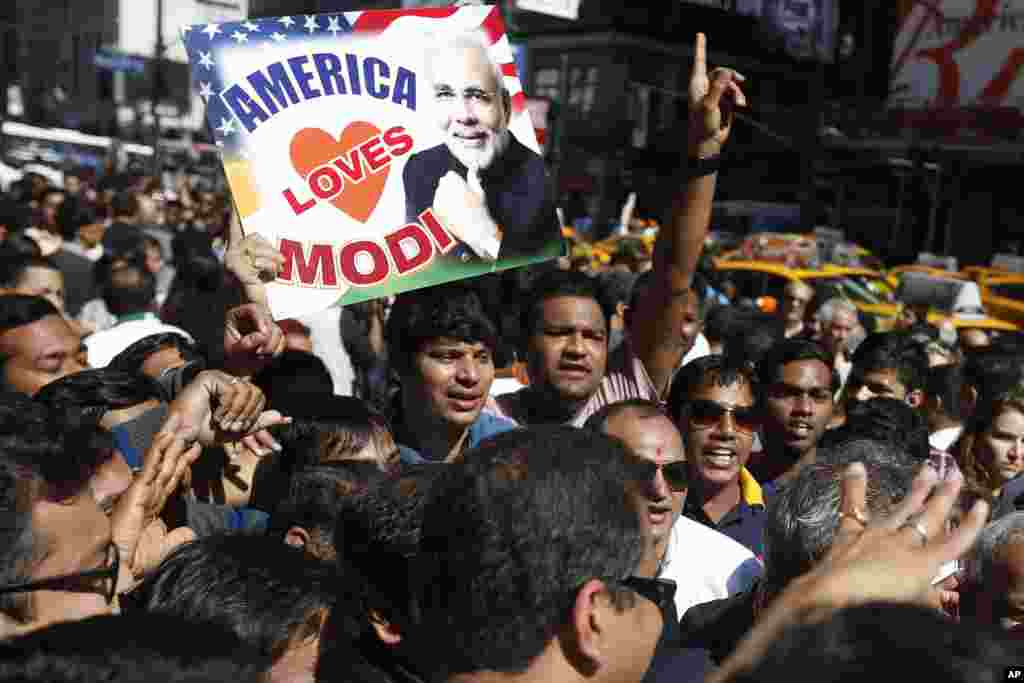 Supporters of Prime Minister Narendra Modi of India crowd the streets after Modi gave a speech during a reception by the Indian community in honor of his visit to the United States, Madison Square Garden, New York, Sept. 28, 2014.