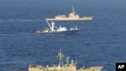 In this photo released by the Spanish defense ministry the Spanish trawler Alakrana is seen at center, escorted by two Spanish frigates in a photo taken off Somalia's coast, November 17, 2009