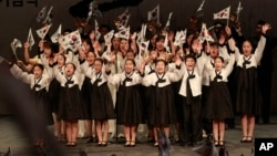 Elementary school students wave South Korean national flags during a ceremony to celebrate the March First Independence Movement Day.