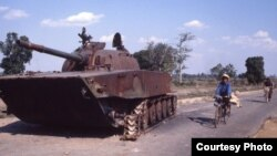 A broken tank used in the civil war was abandoned on a road near the capital in 1980, Phnom Penh, Cambodia. (Courtesy John Burgess)