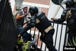 Venezuela's national police detain anti-government protesters during a protest against President Nicolas Maduro's government in Caracas May 8, 2014.