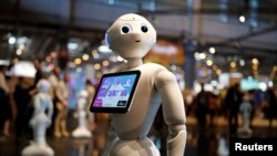 A 'Pepper' humanoid robot, manufactured by SoftBank Group Corp