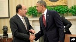 Presiden AS Barack Obama (kanan) menegaskan kepada PM Irak Nouri al-Maliki bahwa AS akan membantu Irak menghadapi al-Qaida dalam pertemuan di Gedung Putih (1/11).