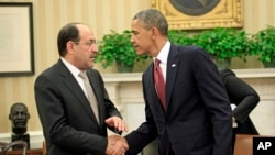 President Barack Obama shakes hands with Iraqi Prime Minister Nouri al-Maliki, Nov. 1, 2013, following their meeting in the Oval Office of the White House.
