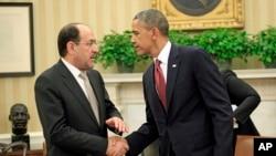 1일 바락 오바마 대통령이 백악관에서 누리-알 말리키 총리와 악수하고 있다.