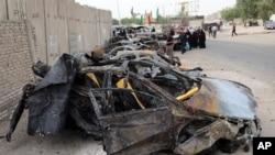 Hiện trường vụ nổ bom xe tại khu vực Shula ở thủ đô Baghdad, ngày 12/10/2014.