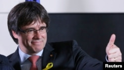 Carles Puigdemont, the dismissed president of Catalonia, arrives to speak after watching the results of Catalonia's regional election in Brussels, Belgium, Dec. 21, 2017. Saturday he called for talks with Spain.
