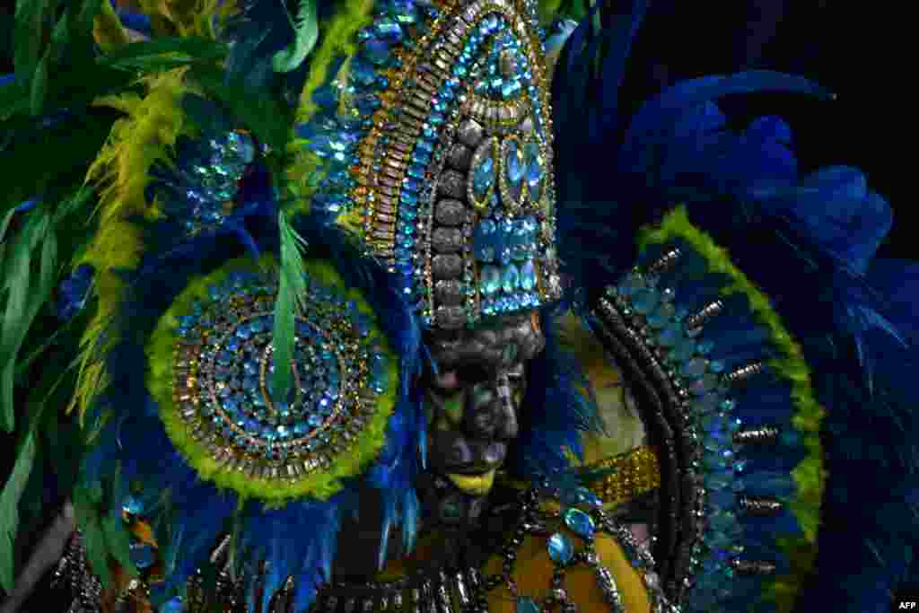A reveler of the Unidos de Vila Maria samba school performs during the second night of carnival at the city's Sambadrome in Sao Paulo, Brazil.