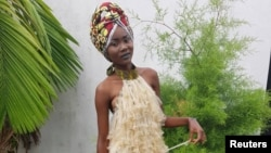 A model poses in a dress made of condoms by Felicite Luwungu in Kinshasa, Democratic Republic of Congo, Dec. 5, 2017.