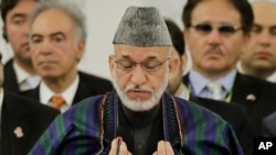 Afghan President Hamid Karzai delivers a speech (July 8 2012 file photo)