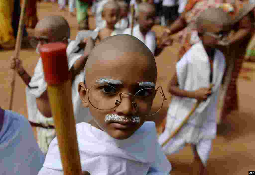 Indian school children dressed like Mahatma Gandhi assemble during an event at a school in Chennai, ahead of Gandhi's birth anniversary.