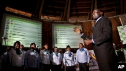 In an attempt to fill the long stretches of time without briefings to the media or announcement of electoral results, a choir sings songs in front of electoral results boards at the National Tallying Center