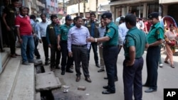 Bangladeshi police officers are seen investigating at the location where three motorcycle-riding assailants attacked secular student activist Nazimuddin Samad, in Dhaka, Bangladesh, April 7, 2016.