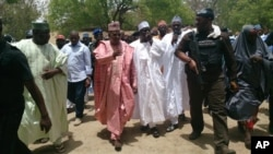 Borno state governor Kashim Shettima, center, visits the secondary school Chibok, were gunmen abducted more than 200 students in Chibok, Nigeria, April, 21. 2014.