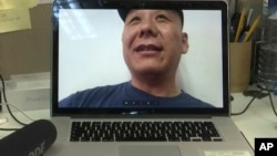 Chinese dissident Zhang Xiangzhong is seen on a computer screen during an interview via videoconference April 17, 2017, in Taipei, Taiwan.