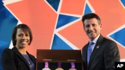 Chairman of London 2012 Olympic Games, Sebastian Coe, right, and Olympic gold medalist Kelly Holmes show off the Olympic medals for next year's summer games, Wednesday, July 27, 2011.