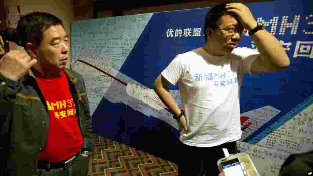 Steve Wang a representative from the committee for relatives of Chinese passengers onboard Flight MH370 talks to journalists after a closed door meeting with Malaysian officials via teleconference in Beijing, April 2, 2014.