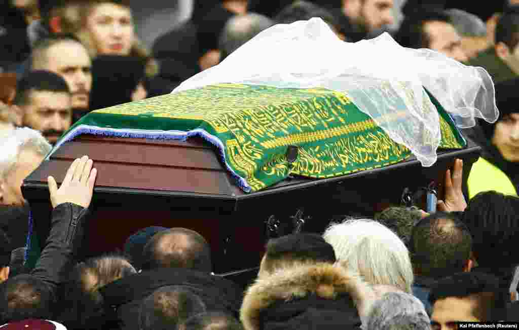 Mourners carry the coffin ofTugce Albayrak outside a mosque during a memorial service for late student in Waechtersbach, Dec. 3, 2014..