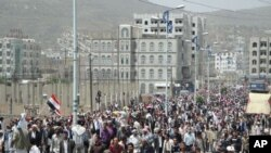 Anti-government protesters march in the central Yemeni city of Ibb to demand the ouster of President Ali Abdullah Saleh, March 30, 2011