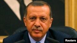 FILE - Turkey's Prime Minister Tayyip Erdogan addresses the media in Ankara, Aug. 15, 2013.