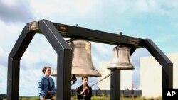 Matthew Prosser and Gina Rhoads of Shanksville-Stonycreek High School ring the Bells of Remembrance during the service of remembrance tribute to the passengers and crew of Flight 93 at the Flight 93 National Memorial in Shanksville, Pennsylvania (AP Photo/Jared Wickerham, File).