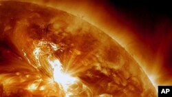 This NASA image shows a solar flare erupting on the Sun's northeastern hemisphere, January 22, 2012.