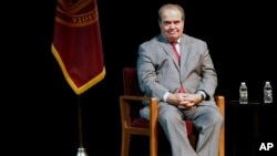 FILE - In this Oct. 20, 2015, photo, US Supreme Court Justice Antonin Scalia waits during an introduction before speaking at the University of Minnesota.