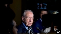 Senate Judiciary Committee Chairman Chuck Grassley, R-Iowa, speaks to reporters on Capitol Hill, Wednesday, Sept. 19, 2018, in Washington.