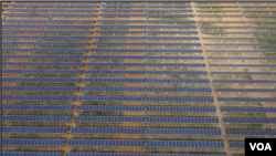 FILE: About 7,000 solar panels are seen at this power plant 50 kilometers northwest of Harare, Zimbabwe. Centralgrid, which owns the plant, says will generate 2.5 megawatts starting next month to be fed into Zimbabwe's power grid (C. Mavhunga/VOA)