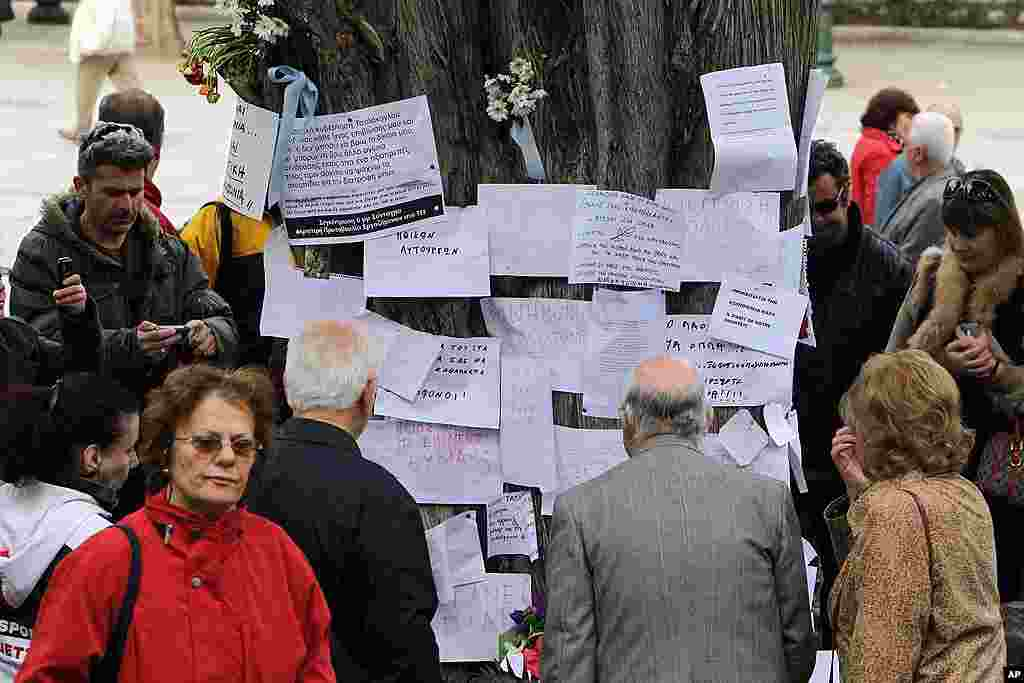 People gather at the site where an elderly man fatally shot himself at Athens' Syntagma square. (AP)