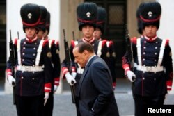 FILE - Then-Italian Prime Minister Silvio Berlusconi walks before a meeting at Palazzo Chigi in Rome, Nov. 13, 2009.