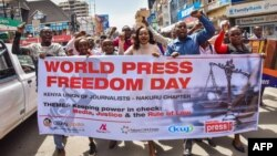 FILE - Journalists and activists march during World Press Freedom Day, May 3, 2018, in Nakuru, Kenya.