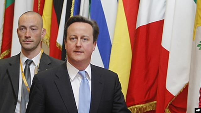 British Prime Minister David Cameron leaves an EU summit in Brussels on December 9, 2011.