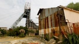 Corrugated iron rusts beneath disused mine shaft at the Aurora gold mine, 50 km (31 miles) east of Johannesburg, Feb. 2, 2011.
