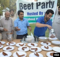 "Abdul Rasheed, in gray Pathani suit, offering beef kabab at his ""Beef Party"" in his official residence in Srinagar on 7 October, 2015. (Pirzada Firdous Ahmad/VOA)"