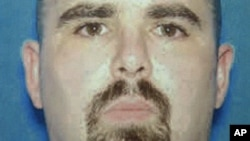 This undated photo provided by the FBI on Aug. 6, 2012 shows Wade Michael Page, a suspect in the Sunday, Aug. 5, 2012 Sikh temple shootings in Oak Creek, Wis.