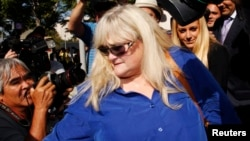Debbie Rowe, ex-wife of singer Michael Jackson, leaves after testifying in a lawsuit brought by the late singer's family against concert promoter AEG Live, at Los Angeles Superior Court in Los Angeles, California, August 14, 2013.