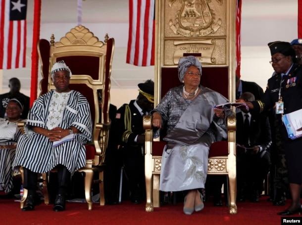 FILE - Liberian President Ellen Johnson-Sirleaf (seated R) and Liberian Vice President Joseph N. Boakai (L) attend Sirleaf's second presidential inauguration at the Capitol in Monrovia, Jan. 16, 2012.