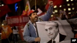 A demonstrator shouts slogans against Brazil's President Michel Temer during a protest in Rio de Janeiro, Brazil, Sept. 22, 2016.