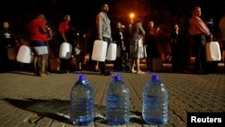 People queue to collect water from a spring in the Newlands suburb as fears over the city's water crisis grow in Cape Town, South Africa, Jan. 25, 2018.