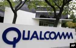 FILE - The corporate sign of Qualcomm Inc. is seen in front of its office in Santa Clara, California, April 18, 2011.
