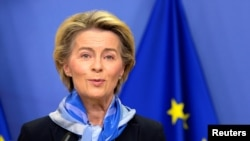 European Commission President Ursula von der Leyen gives a statement after the European Medicines Agency (EMA) gave the green light to European countries to start COVID-19 vaccinations in the coming days, following regulatory approval for the use of a sho