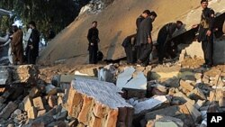 Violence continues to erupt in the Pakistani border region of Mohmand. Pakistani officials search among the rubble of a destroyed building following a suicide attack on an administrative compound in Ghalanai, Dec. 6, 2010.