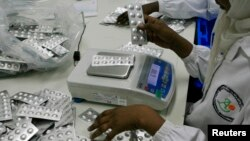 Employees inspect medication tablets produced at Azal Pharmaceutical Industries in Khartoum, (File photo).