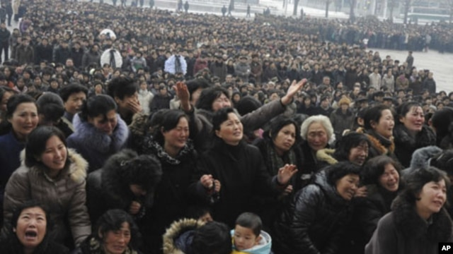 Pyongyang citizens grieve as they visit a portrait of late North Korean leader Kim Jong Il on display in the plaza of the Pyongyang Indoor Stadium in Pyongyang, North Korea, December 21, 2011.